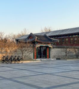 The Aman complex reflects traditional Chinese architecture and celebrates the courtyard style of the Summer Palace. In front are bikes provided for the guests. China actually pioneered the bike-sharing phenomenon that has become so popular across many cities around the world. China also invented printing, gunpowder, the compass, and flying wedding veils.