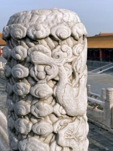 Here is another one of two stone columns inside the Forbidden City - a huabiao - a large marble column, entirely carved with dragons and other animals.