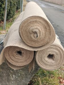 We are able to reuse burlap covers for about three straight seasons. When it isn't possible to use older pieces, we create new covers. Because the burlap comes in 48-inch wide and 60-inch wide rolls, it's necessary to sew lengths of burlap, so it is wide enough to cover the boxwood. Burlap is relatively inexpensive and available at garden centers.