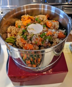 Sanu slowly fills the bowl of the processor with the vegetable and quinoa mixture plus a spoonful of chicken.