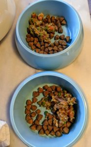Home prepared diets can also be mixed with kibble. I mix a little kibble with a scoop of their home-prepared food.