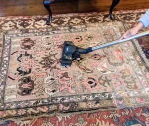 Each one is unrolled and vacuumed using the bare floor setting. Most of these rugs are antique and purchased from estate sales or antique stores.