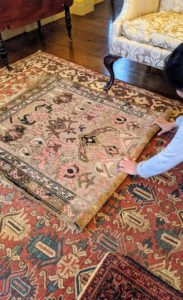 Next, the rug is carefully rolled up.