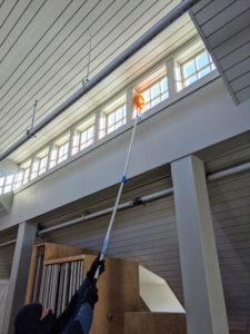 This loft has high ceilings and lots of windows. It needed a good cleaning, so the outdoor grounds crew began at the top and worked its way down. Here's Phurba dusting one row of windows. Hay creates a lot of dust, so this is done on a regular basis.