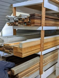 The crew organized all the moldings on the shelves, making sure they were stacked according to length and type.