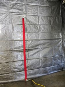Here is a view of the finished tarp wall - it looks terrific. This is an inexpensive solution for separating a space.