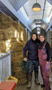 Carlos and Helen stop for this quick photo after the tarp wall is completed, all the hay is stacked, and the floors cleaned.