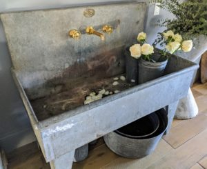 I loved this sink, and wanted to take it home - I admired its shape, size, and construction and thought it would be a great addition to a new project at my farm. Unfortunately, it is not for sale. It is actually a working sink in the shop for floral arrangements etc.