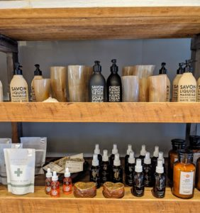 "Specialty liquid soaps, creams, bath salts, and other aromatic spa items are on this shelf. Jenny describes the shop as filled ""with curiosity and wonder."""