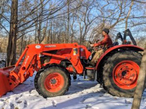 Chhiring is my outdoor grounds crew foreman. He is an excellent driver and operates all the large machinery at the farm. This is our trusted Kubota model M7060HD12 tractor. It is used for many jobs.