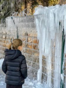 It was bitterly cold in China - sub-zero temperatures. Here is Jude looking at some of the massive icicles that were hanging at the base of The Great Wall.