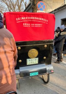 This is a rickshaw, the most popular form of transportation for those taking a Beijing hutong tour. It is a small covered two-or-three wheeled cart usually for one passenger that is pulled by one driver.