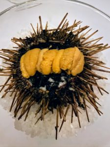 "And this is cooked uni. Five strips or ""tongues"" of uni live within the structure of a sea urchin. They are usually orange or yellowish, and do resemble tongues, with the consistency of firm custard."