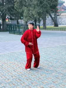 Although in imperial times the public was not allowed to enter the enormous park at the Temple of Heaven, it is now a place where local residents often go for early-morning exercises. This is Miss Li, our Tai Chi instructor.