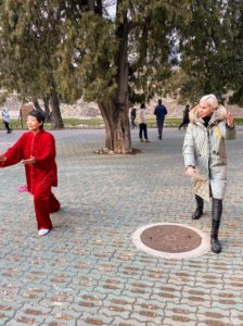 Here's Alexis taking a lesson with Miss Li. Tai chi, short for T'ai chi ch'üan or Tàijí quán, is an internal Chinese martial art practiced for both its defense training, its health benefits, and meditation.