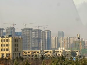 The countryside was changing. Look at all the cranes on these tall buildings.