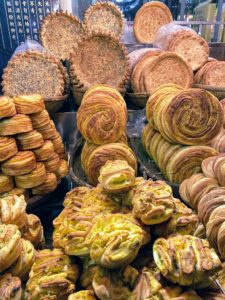 Once in Xi'an, we went to the Muslim Quarter, where we toured the Beiyuanmen Night Market filled with delicious foods. Here is one vendor booth filled with all kinds of bread.