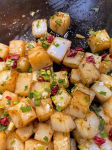 This is called hotplate tofu, a griddled tofu dish with chili peppers and scallions.
