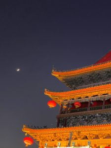 Outside, I captured this beautiful photo of the moon in the night sky next to the Muslim temple. It was another fun-filled and informative day in China. In my next blog - the famous Terra-Cotta Museum.