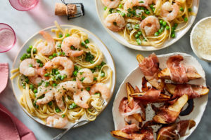 If you want to make a special meal, sign up for Martha & Marley Spoon. This Valentine's Day Shrimp Fettuccine Alfredo with Prosciutto-Wrapped Pear & Balsamic Glaze is so delicious and can be made in 30-minutes. Cancel your dinner reservations; this is the perfect no-fuss Valentine's Day dinner at home. This two-course meal starts with sweet caramelized pears wrapped in prosciutto. The next course, al dente fettuccine is enrobed in creamy Alfredo sauce and served with sweet shrimp and peas.