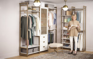 "Here I am with our closet modular system in the ""Perry St. White Woodgrain with Gold Metal"" finishes. Don't you love it? The system is practical and well-designed and can be adjusted to fit all your organizing needs."