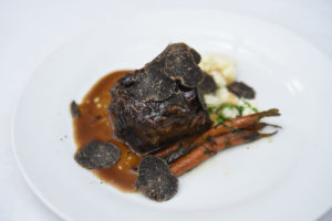 The next course was braised short rib with ricotta, gnocchi, black truffle, and red wine jus. (Photo by WorldRedEye.com)