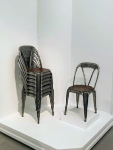 """This was very interesting - """"Stacking Chairs,"""" 1926. They look like leather but are actually only made of steel and plywood. These chairs illustrate a common manufacturer's decision to reduce cost while maintaining an appearance of luxury."""