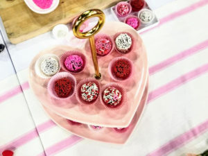 The finished truffles are sitting on my Ceramic Heart 2-Tier Server from Macy's. Use it for a buffet or gathering with its charming pink ceramic heart-shaped tiers and gold-tone accents.