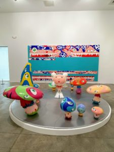 "These works are by Takashi Murakami. The installation is called ""DOB in The Strange Forest,"" 1999, showing one of the artist's favorite characters lost in a forest of many-colored mushrooms."