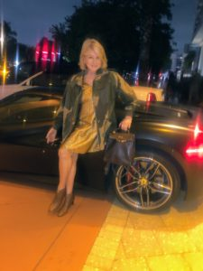 Here I am dressed up for dinner in my gold Lanvin dress, Victoria Beckham Camouflage Military Jacket, Hermes boots and my Hermes leather backpack, which I purchased in Japan before backpacks became popular. I stopped for a photo in front of this glamorous matte black Ferrari, but don't worry - I was very, very careful not to let anything mar this beautiful car. On my next blog, more from my Super Bowl weekend - including photos from the Big Game!