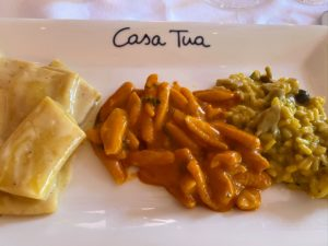 And three kinds of pasta, including the cavatelli with tomato sauce and basil in the center.