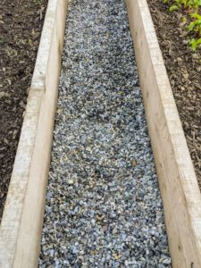 Recently, we also put down a fresh layer of gravel between the beds.
