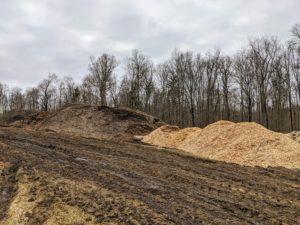 I designate one location on my farm for a compost yard – one of the most important areas on the property. Here, I keep various piles of shavings, mulch, compost, and wood.