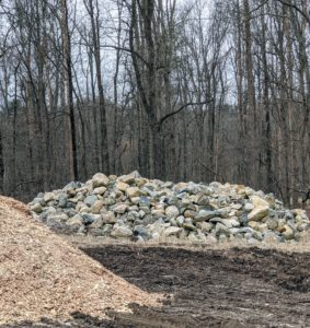 In this pile - large boulders. These are also saved for future use.