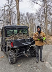 Jason is picking up smaller twigs and branches and carting them off in our trusted Polaris Ranger 1000.