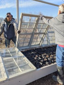 Once the paint is dry, Pete and Fernando carefully close the cold frame windows. The important thing is that the box doesn't let air inside.
