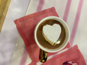 If you don't have time to make your own marshmallows, you can use the jumbo, regular, and mini store-bought varieties. Just cut a marshmallow in half to make two circles, snip the tops and pinch the bottoms, then set them afloat in the mug.