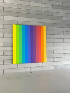 """This piece is """"Spectrum IX"""" (2014) in Room 1 of the Pavilions. This work by Ellsworth Kelly is part of the artist's Spectrum series, composed of twelve joined monochromatic panels. The painting is among the last works completed by the artist before his death in 2015."""