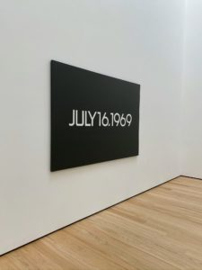 """This painting is part of a triptych titled """"Moon Landing"""" (1969) by On Kawara. The installation features three Date Paintings from the Today series (1966–2013) that together commemorate the Apollo 11 lunar landing mission in July 1969. Each large-scale canvas bears a date documenting the mission's launch (July 16, 1969), the landing of the lunar module (July 20), and man's first steps on the moon (July 21)."""