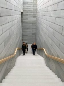 Here I am on the staircase between the Entry Pavilion and Room 1. The only space in the Pavilions that is at ground level is the Entry Pavilion, so this staircase brings visitors up to the main level of the building.