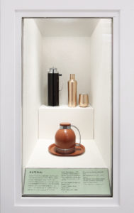 In this case - a look at the materials used for canteens. On top is a Thermoshaker, c. 1933, next to a more modern Metallic Canteen and Stemless Cup, 2016, from Corkcicle. Corkcicle focuses on creating stylish products that are reusable. These canteens are triple-insulated to keep the contents cool or hot. The bottom item is a pitcher and tray by Thermos in 1935, made from aluminum, steel, and enamel. (Photo by WorldRedEye.com)