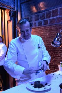 Michael stopped for a quick photo as he plated one of the courses. (Photo by WorldRedEye.com)
