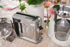 Here is a vintage toaster used as one of the centerpieces. Notice - it can only toast one piece of bread at a time. (Photo by WorldRedEye.com)