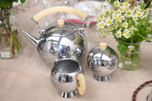 Here is a vintage tea set - the tea kettle, creamer and sugar bowl in stainless steel with Bakelite handles. (Photo by WorldRedEye.com)