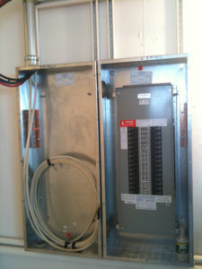 An electrical panel - but why is a water bottle sitting there?