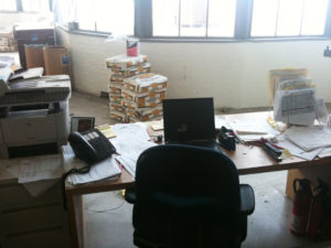 This is the cluttered construction superintendent's desk amidst all the other clutter.