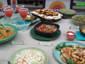 Watermelon margaritas, stuffed jalapeños, tequila-grilled shrimp, grilled skirt steak with poblano relish, shredded cabbage and radish salad, pinto beans with bacon and scallions, red rice, salsa fresca, and tres leches cake