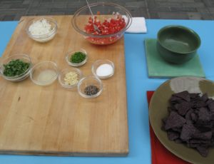 The salsa fresca consists of chopped tomatoes, diced onion, minced jalapeño, minced garlic, fresh lime juice, and cilantro leaves. - http://www.marthastewart.com/recipe/salsa-fresca