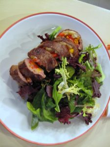 Once they're sauteed in a bit of olive oil, the rolls are sliced and served with mixed greens.