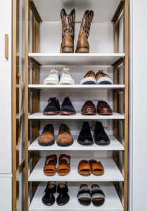 They created ample space for all their personal items including this entire shelf for shoes. (Photo by Andy Frame, andyframe.com)